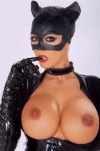 Женщина кошка с большими сиськами
